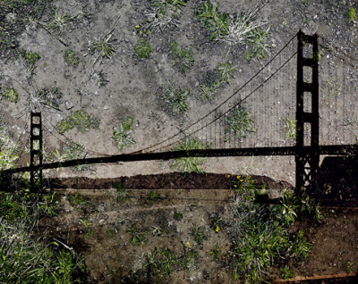 "Abelardo Morell, Tent-Camera Image on Ground: View of the Golden Gate Bridge From Battery Yates, 2012.    The work behind is not only incredible but simple and by simple, I don't mean easy. The installation and the process to get these pictures are inspiring.   From Discover Mag  ""Recently, I began to wonder what it would be like to marry images of landscapes with the surface of the ground nearby. I have worked with my assistant, C.J. Heyliger, on designing a light proof tent that, via periscope type optics, makes it possible to project a view of the nearby landscape onto whatever ground is under the tent. Inside this darkened space I use a view camera to record the effect, which I think is a rather wonderful sandwich of two outdoor realities coming together. This Tent-Camera now liberates me to use camera obscura techniques in a world of new places."""