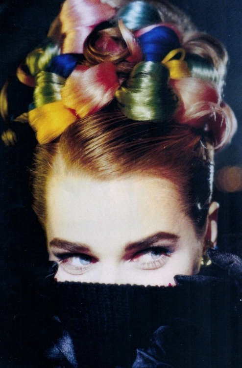 "Rebecca Romijn in ""Pulls Technicolor"" photographed by Christophe Gstalder for ELLE France, December 1991"