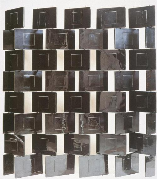 kecobe:   Eileen Gray (British; 1878–1976) Screen: Block Black lacquered wood blocks, pivoting on steel rods, ca. 1925 Several variants exist of this idea, with different sizes for the block unit and with varying numbers of blocks and overall proportions; this particular screen was acquired by Jean Badovici