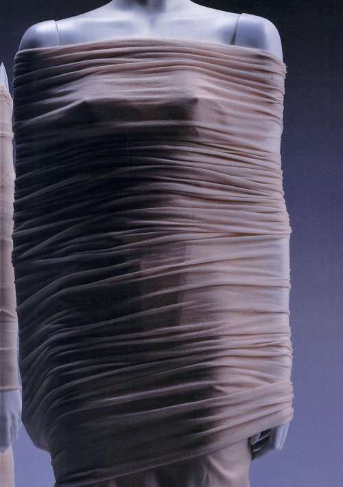 "spring1999:  Issey Miyake S/S 1998 dress  Beige-pink woolly nylon knit one-piece dress; cotton and silk mix underdress.In 1998, Miyake became interested in tubular knits, and started to research on how to apply the functional feature of knits. Miyake's determination led to the mixture of knitting and contemporary innovative technology, which culminated the birth of ""A-POC"". The cylindrically designed piece goes against all the functional features of a knit such as lightness, resistance to wrinkles, and adaptability to any shape.  Fashion: A History from the 18th to the 20th Century (Collection from the Kyoto Costume Institute) by Akiko Fukai, published by Taschen, 2006"