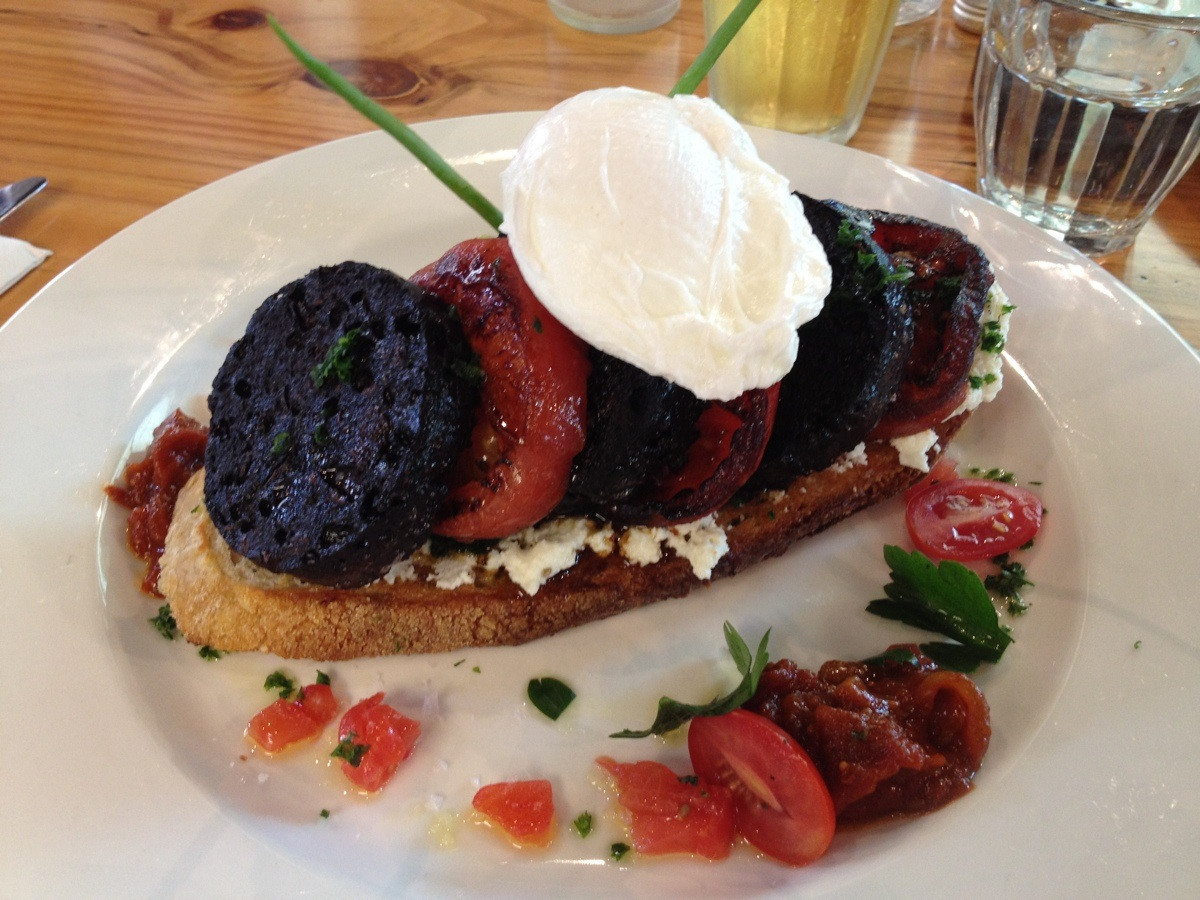 My brunch: Sourdough bread with fried black pudding, grilled tomatoes and poached egg