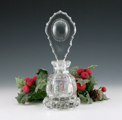 "beautifulantiqueglass:  Antique Czech Crystal Medallion Perfume Bottle Big crystal perfume bottle made in the early 20th Century in Czechoslovakia.  Shown in Whitmyer's Bedroom and Bathroom Glassware of the Depression Years. It measures 7.25"" tall and weighs 1 lb.  Made of heavy thick colorless lead crystal.  Pressed in a 3-part mold. The pattern is known as 'Beaded Medallion'.  The large oval medallion on the stopper works like a magnifying glass.  The bottle has 6 panels, each with a protruding oval medallion.  The base is trimmed with 'cannon balls'. Beautiful bottle with lots of sharp corners and edges.  No chips.  No discoloring.  The bottle and stopper necks are ground to fit.  At the end tip of the stopper's ground insert, where it fits into the bottle's neck, are very tiny chiggers which are common and can't be seen unless looked for. The elaborate stopper has sharp bevelled scallop edges in perfect condition.  Stunning on your vanity…and very usable."