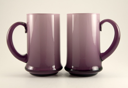 "Carlo Moretti Mid-Century Modern Glass Bar Mugs Very hard to find mugs in Carlo Moretti's famous creamy cased glass. Rarely seen mid-century beer mugs by Moretti, Italy, 1950s-1960s.  Goblets and vases can be found, but the beer mugs are elusive. Cased in white and amethyst, resulting in a beautiful graduating grape color.  Hand formed solid amethyst handles are applied.  Space age styling on the tapered bases.  Full-size beer mugs measure 5½"" tall.  Click here to learn more about Italian Glass. In perfect condition.  Great gift with some fine beer for your favorite drinking buddy. Set of two."