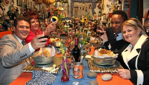 dynamicafrica:  Come Dine with Me SA is far more than bad TV — it's a fascinating look into the state of race relations  Watching the show becomes an exercise in judging citizens of the new South Africa as they try to impress each another and viewers with their gastric fixes. In the Pretoria mopani worm episode, I found myself ultimately disliking all four contestants — perhaps my misanthropy is beyond repair.  The accounts that each candidate  presents of themselves don't help; people rarely get themselves right. Or it could be that the unnatural exposure fails to do justice to the poor, no doubt complicated, suckers.  And suck on food they certainly do, mostly on fairly plain dishes given foreign, exotic names in European languages — French has been the most prominent, as one would expect of upwardly mobile globalisers. Durban's Millie serves up a chicken pie Frenchified as a vol-au-vent, although she seemed quite likeable in other respects.  (read more)