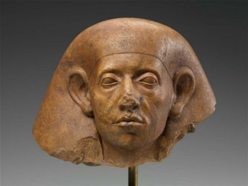ancientpeoples:  Head of a nobleman Late Middle Kingdom, Dynasty 12, 1878–1841 B.C. Reddish brown quartzite head of an official, with distinctive features of late dynasty 12, including large ears, heavily-lidded and sunken eyes, furrowed brow, hollow cheeks and downturned mouth. Nose broken. (Source: Boston Museum of Fine Arts)  12th Dynasty sculpture, though. <3