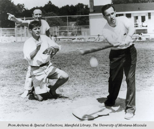"Mike Mansfield, John F. Kennedy, Henry ""Scoop"" Jackson playing baseball. Kennedy is catcher, Jackson is at bat, Mansfield is umpire. (Maureen and Mike Mansfield Library, The University of Montana-Missoula)"