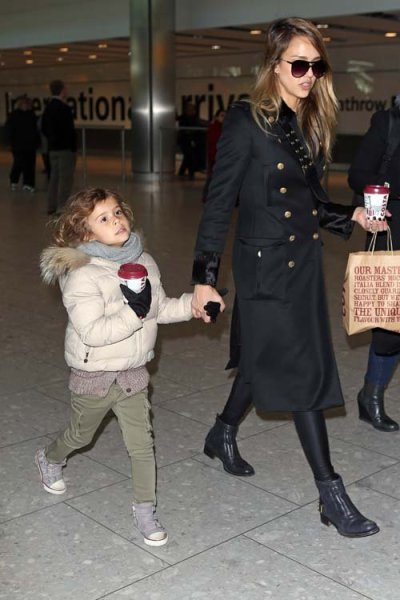 Jessica Alba  + daughter Honor arriving at Heathrow airport in London Saturday…