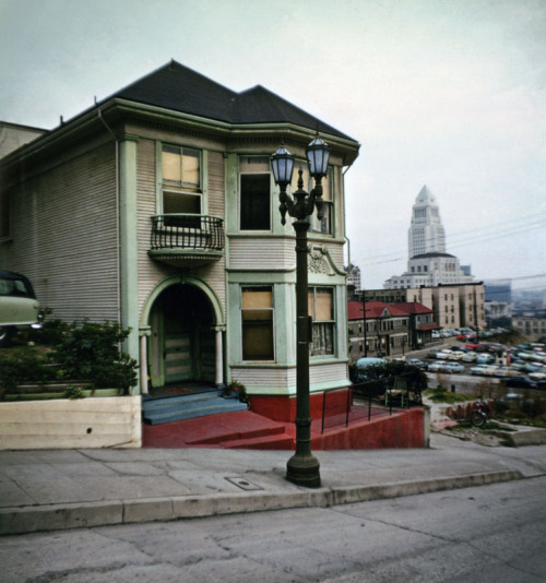 The Koster House, 507 W. Second Street, 1960's. The home has since been demolished. City Hall and the Times building can be see in the background. From a series by George Mann.