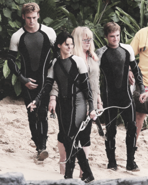 ask-the-hunger-games-characters:  Seven votes for Peeta. Four for Finnick. One for both.  WE ARE NOT TAKING SIDES.  -Katniss & Annie Your opinion?