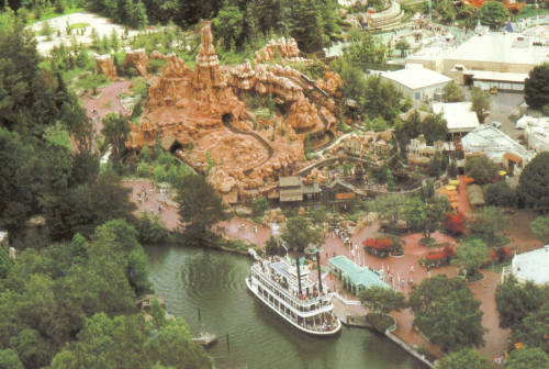 dreamfindersvault:  Aerial photo of Big Thunder Mountain Railroad at Disneyland. This is prior to construction of the Big Thunder Ranch and Festival Arena, which would take up the cleared/partly grassy space at the back left of photo. The three 'isolated' rock structures across the path from Big Thunder are remnants of the Nature's Wonderland ride's Living Desert area, and are still in the park to this day, though more greenery grown around up around them and fencing added.