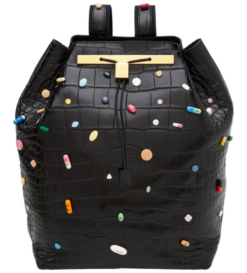 Prescription Pill Backpack The Olsen twins collaborated with Damien Hirst to come up with a limited edition crocodile backpack adorned with prescription pills. It's priced at $55,000. Yes, that's fifty-five thousand dollars. Twelve of these tacky obscenities will be made, proving there are at least a dozen super-rich art-tards who will buy anything with Hirst's name on it.