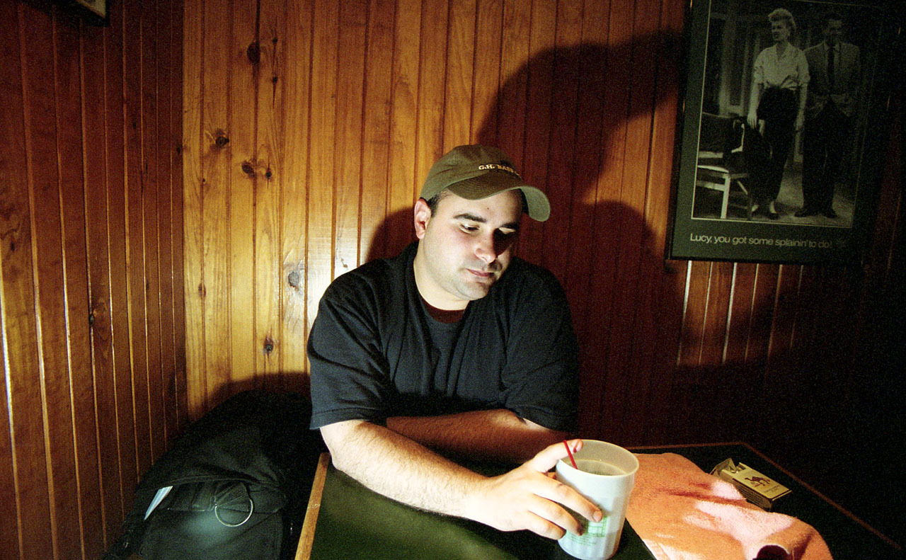 Portrait of the artist in the mafia booth at Shakespeare's in 2002. Probably taken by Cecelia.