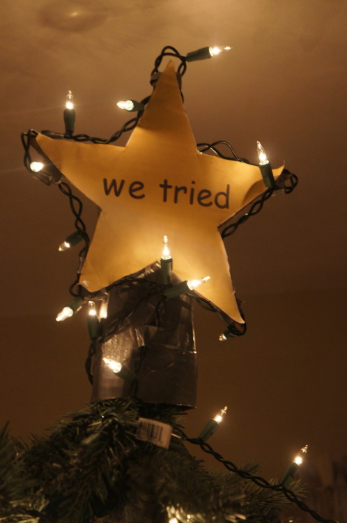 peetuhs:  so my dad told my brother and i to decorate our tree and it turned out looking pretty crappy AND we couldnt find the angel we usually put on top so we made this ta da