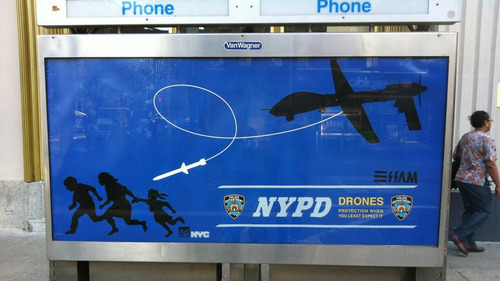 "soupsoup:  Street Artist Behind Satirical NYPD ""Drone"" Posters Arrested  ""A street artist who hung satirical posters criticising police surveillance activities has been arrested after an NYPD investigation tracked him to his doorstep."" Note the irony of the artist satirizing drones getting tracked."