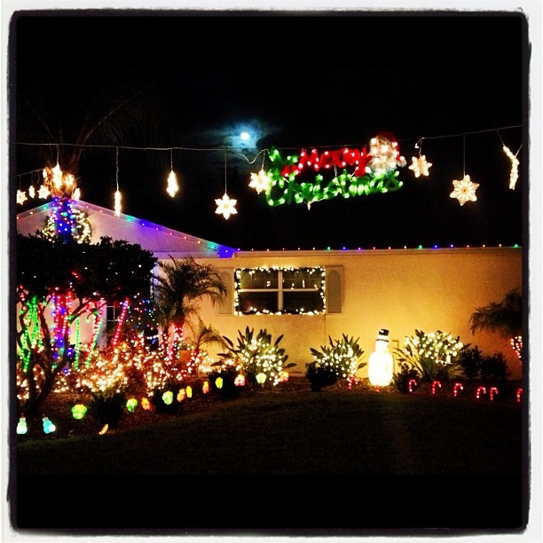 Floridians do it up right. Festive holiday lights behind my grandmother's house mesmerize all who pass.  (at Melbourne Beach)