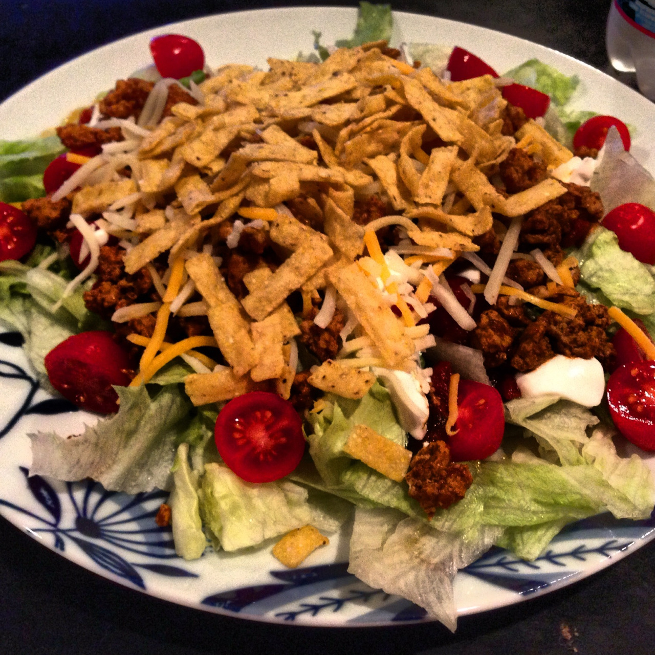 I know I have posted pictures of taco salads before but they are just so darn pretty! I can't get over the colors in this delicious meal. Plus, it's really low in points but super filling.   Lettuce, cherry tomatoes, salsa, reduced fat sour cream, ground turkey with taco seasonings, reduced fat Mexican blend cheese, tortilla strips. 11PP. For real! It was spicy and fresh and so good!