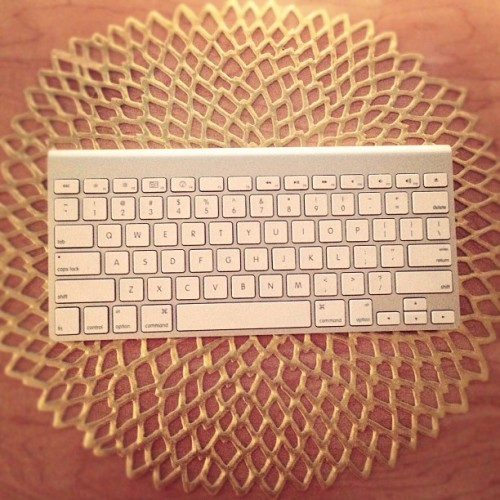 Gold cutout placemat makes a great keyboard blingy bling.