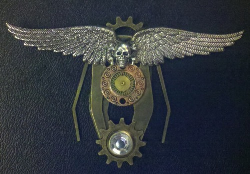 The Angels of Death pin.Awarded to pilots that have displayed extraordinary skill in air to air combat with over 100 successful missions and a minimum of 50 confirmed air to air combat kills.