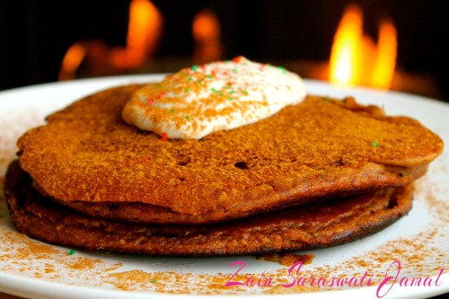 Zain's Christmas Gingerbread Pancakes Who says you have to wait till Christmas Day for gingerbread?  My famous, clean, gingerbread pancakes are the best excuse to enjoy Christmas breakfast all December long starting….NOW!!   Ingredients: 8 Organic Egg Whites 3/4 Cup Slow Cook Organic Oats 1/2 Tbsp Organic Flax Seeds 2 Tbsp Molasses  1/2 Tsp Natural Vanilla 1/2 Tbsp Fresh Ginger (minced) 1/4 Tsp Powdered Ginger 2 Tsp Extra Virgin Coconut Oil (divided) 1/4 Cup Fat-Free Greek Yogurt (optional) 1 Tsp Baking Powder 1/4 Tsp Nutmeg Optional Toppings: 11/2 Tbsp Maple Syrup, pinch of cinnamon , sugar-free sprinkles and a dollop of Greek yogurt or coconut whip to top Directions:  1. Blend all ingredients in magic bullet or food processor 2. Heat coconut oil and then spread batter evenly over pan 3. Cook until golden and slightly crispy on both sides 4. Top with cinnamon, maple syrup, sugar-free sprinkles and a dollop of Greek yogurt or coconut whip to top