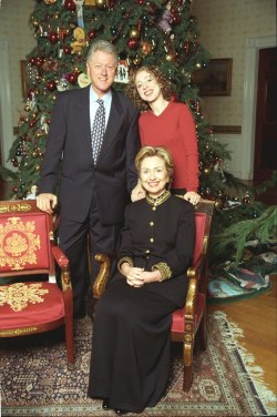 ourpresidents:  The Clinton family poses for a holiday portrait in the Blue Room of the White House.  December 23, 1999. -from the Clinton Library