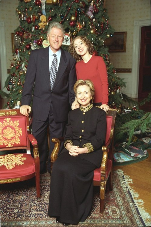 The Clinton family poses for a holiday portrait in the Blue Room of the White House.  December 23, 1999. -from the Clinton Library
