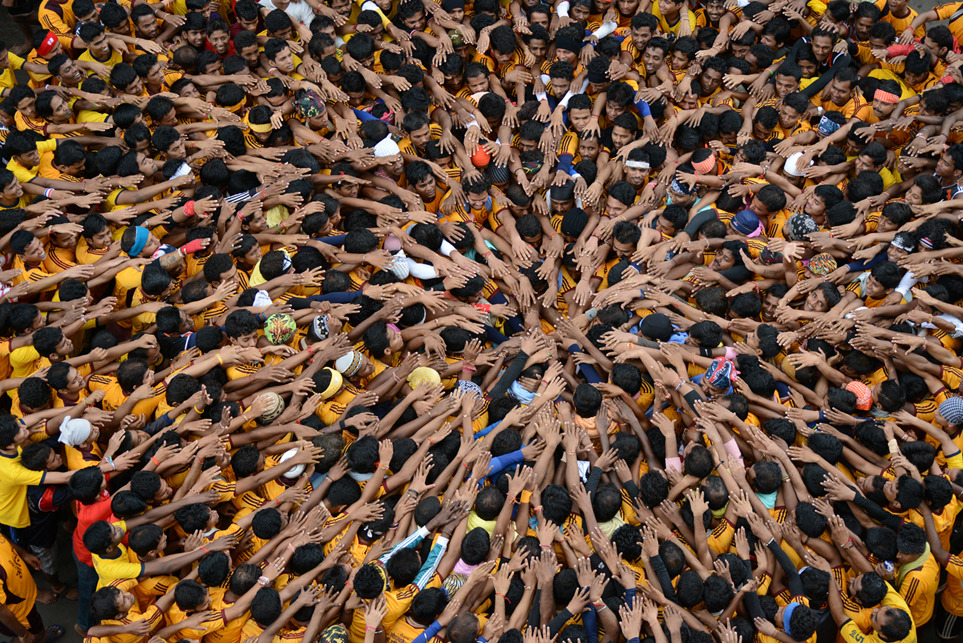 "Photo of the Day: ""Joining hands together is the ultimate symbol of unity. Devotees come together and try to form a human pyramid to break a clay pot containing curd on the eve of the Hindu festival of ""Janmashtami."" Photo by: Sudeep Mehta (Mumbai, India); Mumbai, India."