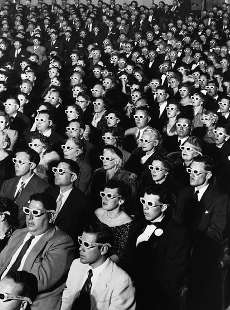 bobbycaputo:  Iconic Photo: Watching Bwana Devil in 3D at the Paramount Theater This iconic photograph by LIFE magazine photojournalist J. R. Eyerman turned 60 this past week. Shot at the Paramount Theater in Hollywood in 1952, the image shows the opening-night screening of the first ever full-length, color 3D movie, titled Bwana Devil.Two interesting facts regarding the image: (1) Polaroid played a role in what the moviegoers were watching and what they were wearing, and (2) the people in the photo didn't actually enjoy the film. Here's what LIFE magazine said about the Paramount audience at the time:  These megalopic creatures are the first paying audience for the latest cinematic novelty, Natural Vision. This process gets a three-dimensional effect by using two projectors with Polaroid filters and giving the spectators Polaroid spectacles to wear. The movie at the premiere, called Bwana Devil, did achieve some striking three-dimensional sequences. But members of the audience reported that the glasses were uncomfortable, the film itself — dealing with two scholarly looking lions who ate up quantities of humans in Africa — was dull, and it was generally agreed that the audience itself looked more startling than anything on the screen.  The December 15, 1952 LIFE magazine issue in which this quote appeared dedicated a full page to the photograph above. It would soon go on to become an iconic image in American culture and the defining image of Eyerman's career.