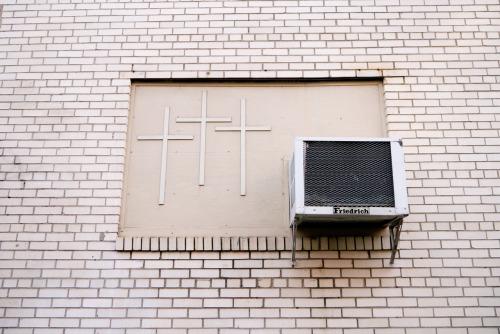 Three crosses and an air conditioner.