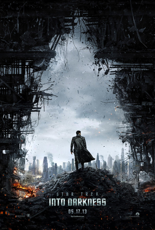 "Paramount has tweeted the first poster for Star Trek Into Darkness. Take note, Tumblrers — that's a Neo-garbed Benedict Cumberbatch we see emerging unscathed from urban destruction (of his own making?) and looking out towards a futuristic metropolis. Set phasers to ""squeal."""