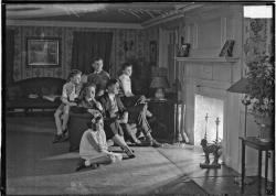 Portrait of Mrs. Walter A. Strong and family gathered in front of a fireplace, 1931, Chicago, Illinois. Photograph by Chicago Daily News, Inc. Want a copy of this photo?  > Visit our Rights and Reproductions Department and give them this number: DN-0009979 Connect with the Museum