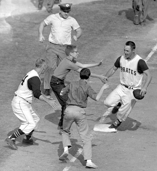 siphotos:  Bill Mazeroski celebrates after hitting a walk-off home run in Game 7 of the 1960 World Series between the Pirates and Yankees. It was the first walk-off home run to win a World Series in baseball history. (AP) GALLERY: Classic Photos of the Pittsburgh Pirates