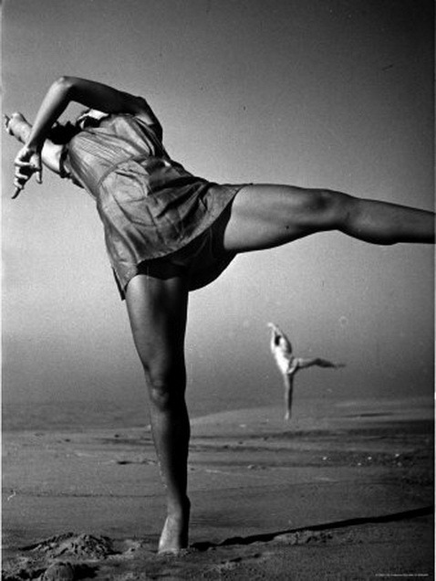 Anita John elongating on the beach. Feels good. Found here