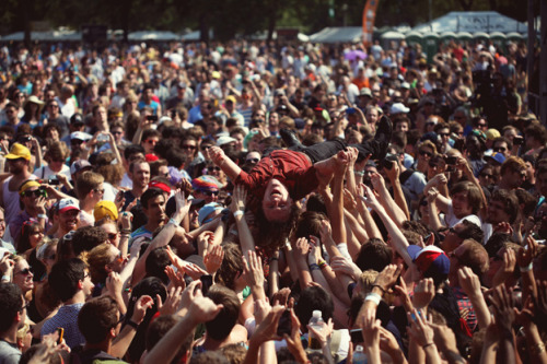 The Year in Photos from Pitchfork features this gem of Ty Segall, riding the waves at the Pitchfork Festival in Chicago.