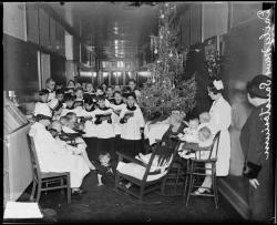 Choirboys singing a Christmas carol in the Chicago Daily News Sanitarium, located in Lincoln Park, 1926, Chicago, Illinois. Photograph by Chicago Daily News, Inc. Want a copy of this photo?  > Visit our Rights and Reproductions Department and give them this number: DN-0082433 Connect with the Museum
