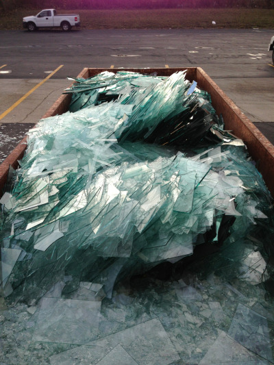 Recycling dumpster full of failed glass designs. Looks glacial.