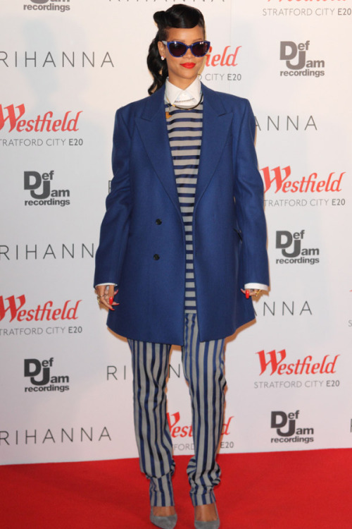 'Tis the season for taking style risks! Rihanna tops off a bold striped top and pant combo with an oversized blazer. Learn more about her look here »