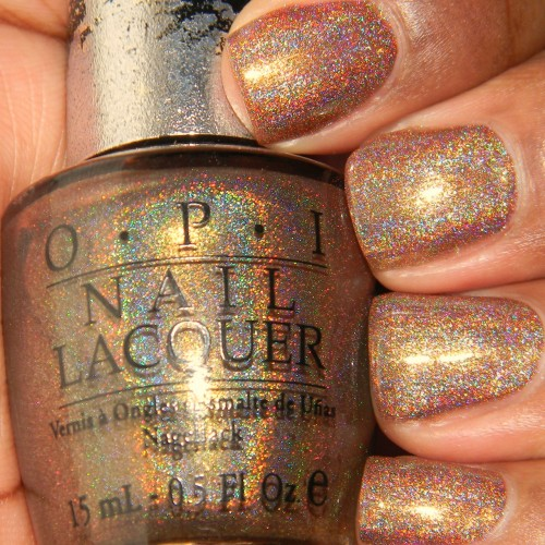 OPI -DS Desire This is my FAVORITE DS polish! Whats better than a gorgeous brown/tan linear holographic? The consistency of Desire is even better than the other DS' I own. Its more watery/thin than the others and that made application easier and smoother. For this photo I applied three coats. Afterwards I added top coat and the holo wasn't muted like most holo polishes. Fin.
