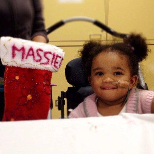 Young Massiel shows off her stocking she helped decorate alongside #Bruins staff @SpauldingRehab.