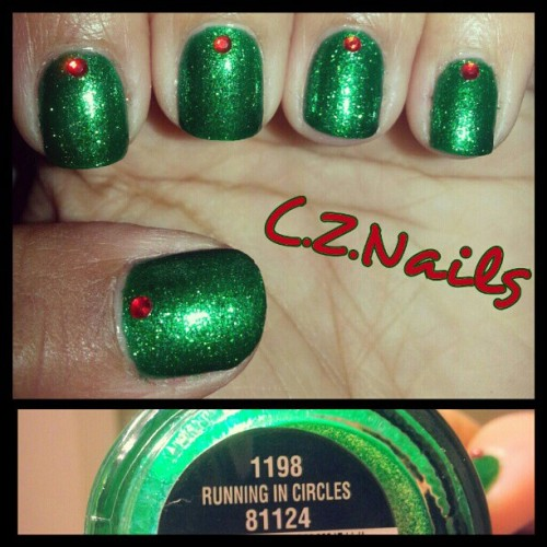 "This green is beautifully amazing!  Its China Glaze ""Running in Circles"". I kept the manicure simple with some little red rhinestones cuz I just really wanted to show how pretty this green :)  #nails #nailpolish #polish #chinaglaze #love #green #naillaquer #rhinestones #nailpolishswatch #pretty  #cirquedesolei #worldsaway #awesome #naillove #instanails #nailartwow #nailartoohlala #nailstagram  @nailartoohlala  @chinaglazeofficial"