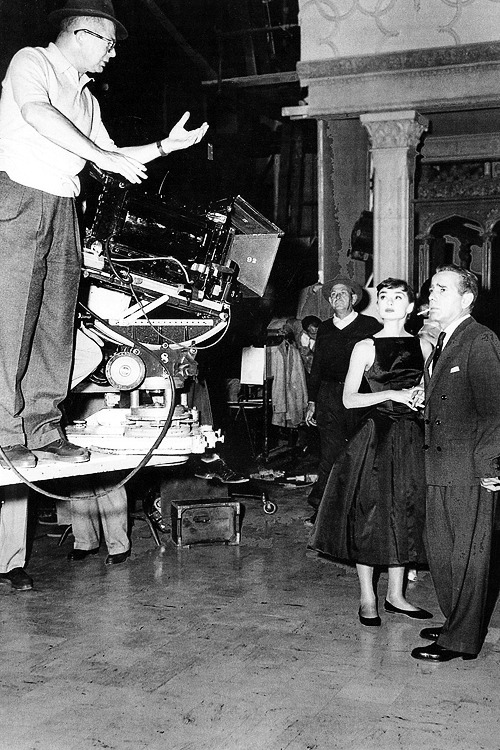 Audrey Hepburn & Humphrey Bogart on the set of 'Sabrina' with director Billy Wilder, 1954.