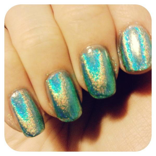 excuse my sloppy mani! way psyched about this new holo polish i picked up today at ricky's @_@  EDIT: it's this polish, from color club.