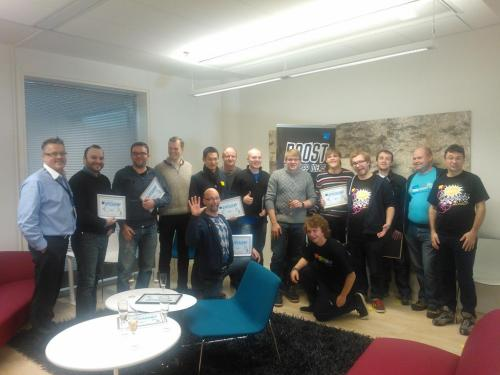 The AppCampus teams with champagne and certificates after graduating from the pilot AppCademy 2012.