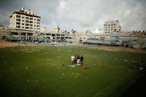 Gaza City, Gaza Strip: Palestinian security guards pray at a football stadium, which witnesses said was destroyed in an Israeli air strike  Photograph: Suhaib Salem/Reuters