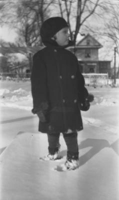 ourpresidents:  Margaret Truman, about the age of five, wearing winter play clothes in the snowy yard of her home at 219 N. Delaware Street in Independence, MO.