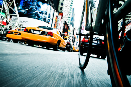 laughingsquid:  New York City From a Bicycle's Point of View  Yeah, these pictures are pretty tight, but it's hella dangerous to get your arm and the camera down that low, no?