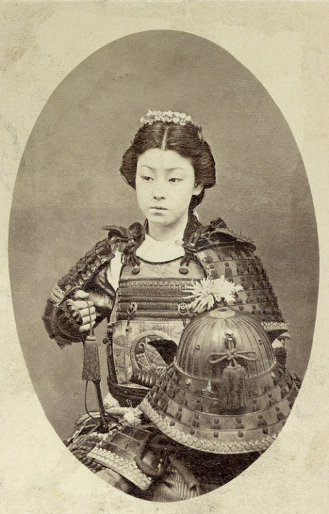 "justamus:   A rare vintage photograph of an onna-bugeisha, one of the female warriors of the upper social classes in feudal Japan. Often mistakenly referred to as ""female samurai"", female warriors have a long history in Japan, beginning long before samurai emerged as a warrior class.   Onna-Bugeisha. Most awesome.  Edit: Okay, apparently not onna-bugeisha, just a photo of a theatre girl. But still plenty cool. Many thanks, Internet."