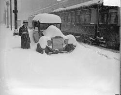 A man standing in knee deep snow as a streetcar passes nearby, 1929, Chicago, Illinois. Photograph by Chicago Daily News, Inc. Want a copy of this photo?  > Visit our Rights and Reproductions Department and give them this number: DN-0090258 Connect with the Museum