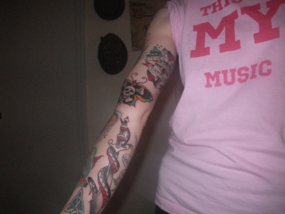 Added more to my Sailor Jerry sleeve yesterday. My new ones are the Devita style snake and dagger, and the skull and cross bones butterfly.  All the pieces in the sleeve were done by Butch Comer @ Max Ink in Geneseo, NY