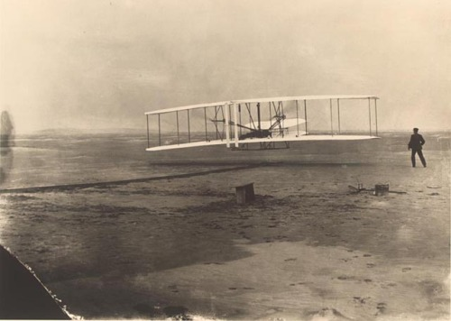 usagov:  Image description: Today is Wright Brothers Day, commemorating the first successful airplane flight in 1903. This photo shows that feat. Learn about the first flight. Photo by John T. Daniels, Library of Congress Prints and Photographs Division