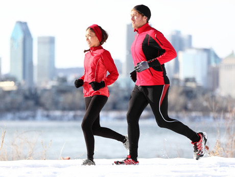 Tips to Dress Properly for Running in Cold Weather How you dress for the elements can make or break your winter runs. This doesn't mean you should pile on all the clothes you can possibly manage to stay warm. It is possible to dress too warmly, and the result can leave you sweaty and uncomfortable. 1. Dress in layers. Wearing several thin layers of clothing helps trap warm air between each layer keeping you considerably warmer than if you were to wear one heavy layer. This includes socks; wearing two pairs of polypropylene socks keeps your feet warmer and drier than one heavy pair. More: 3 Tips for Training in the Cold 2. Wear the right fabrics.    One area where modern runners have a huge advantage on those who started out in the running boom of the late 1970s and 80s is in the types of fabric available for running gear. Materials such as polypropylene, capilene, and some wool/synthetic blends wick moisture away from your body and keep you as warm and dry as possible. Avoid wearing cotton because it doesn't wick moisture and also has very little insulating ability, which will leave you wet, cold and uncomfortable. 3. Wear a protective shell. It's critical that you wear some sort of waterproof windbreaker or shell to protect you from the wind and precipitation. Gore-Tex is the best material to wear as it does a great job of releasing moisture from the body while also keeping out moisture from the outside elements. Nylon also does a reasonable job for a lesser price. 4. Cover exposed skin as much as possible.   A hat and gloves are absolutely necessary once the temperature dips below freezing. Your body will lose the majority of its heat through any exposed skin, so cover up as much as possible. If it's really cold, you can cover exposed areas such as your face with Vaseline to reduce the potential of frostbite. Running in cold weather also presents some unique safety concerns. Extreme temperatures can even pose life-threatening risks if you don't take some basic precautions. 1. Always tell someone where you're going and when you expect to arrive home. Make sure that at least one competent person is aware of your plans. If you don't arrive as expected, they'll recognize that you're missing and know where to look for you. 2. Always wear reflective gear when running after dark. Due to the decrease in daylight hours, it's more likely that you'll be running in the dark during the winter. Make sure you wear light-colored, reflective clothing so that you can easily be seen by oncoming vehicles. 3. Run short loops. When it's cold outside, consider running multiple laps of a short course, rather than one longer loop. This ensures that you'll never be far from home in the event of an emergency. Running a short course also ensures that you won't be heading into bad weather for an extended period of time, which, aside from being extremely unpleasant, can significantly lower your body temperature. 4. Be careful rounding corners.  At least once a year I manage to fall flat on my face after stepping on an icy surface. The biggest risk occurs when you try to change direction with ice underfoot. Make sure you go very slowly when turning corners and be very careful on icy surfaces. Don't worry about losing fitness by running a bit slower; the main goal is to get through the run without pulling a muscle or injuring yourself in a fall. 5. Carry your cell phone, identification and some cash with you for an emergency. If you run into a major problem, make sure you have your cell phone handy and enough cash to get you home if necessary. This is good advice for any run, at any time of year. Sometimes unavoidable circumstances can leave you stranded and you definitely do not want to find yourself out in the cold, unable to run, and several miles from home without help. The main message is this: Running in cold weather requires some planning and some sensible precautions. Once these are taken care of, your runs will be safer, more comfortable and more enjoyable.